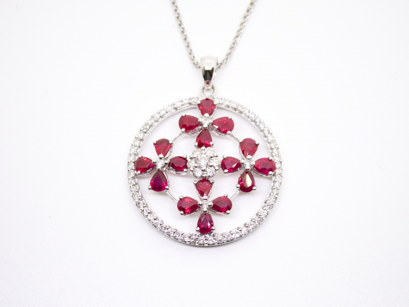 Estate-Pendants - 18KW RUBY DIAMOND FLOWER CIRCLE PENDANT