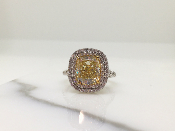 Fancy Yellow Cushion Diamond Engagement  - 18k white gold ring with 4.01CT fancy yellow cushion diamond center and .66CT white diamond halos. Finger size 7.