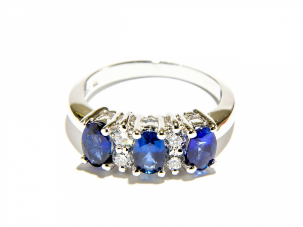 3-Stone Sapphire Ring - This 14K white gold ring has three oval sapphires totaling 1.8 carats and 0.28 carats of diamond. Ring size is 6.5 and weighs 4.68 grams.