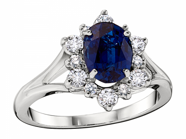 Diamond Star Halo Sapphire Ring - This 18k white gold split shank ring holds a 8x6 prong set oval sapphire center with a diamond star halo. The ring weighs 4.7 grams with a 1.5 carat total of sapphire.