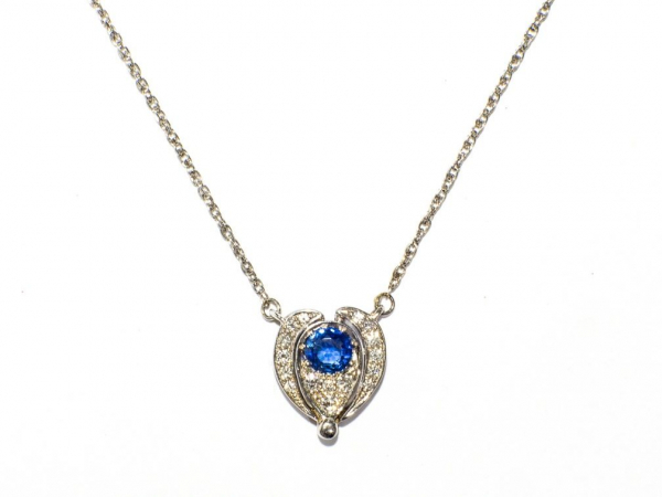 Diamond and Sapphire Convertable Pendant - This 14k white gold necklace was custom made by Travis, our jeweler. It holds a total of .3 carats of diamonds with a round sapphire in the center, that totals .82 carats.
