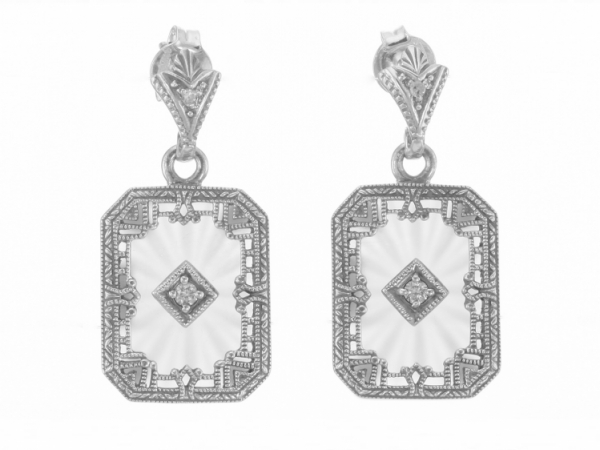 Camphor Glass Art Deco Earrings  - Sterling Silver Filigree Frosted Camphor Glass Crystal with Sunray / Starburst Pattern / Genuine Diamond Art Deco Style Earrings. These Sterling Silver Crystal Filigree earrings are handcrafted and each features a beautiful genuine diamond mounted in the center. A diamond also sparkles at the post of each earring. A matching pendant is available for purchase. Filigree earrings are timeless in style and can be enjoyed, cherished and handed down as precious family heirlooms. These Filigree Art Deco Style Earrings are new and a quality sterling silver antique and collectible reproduction.