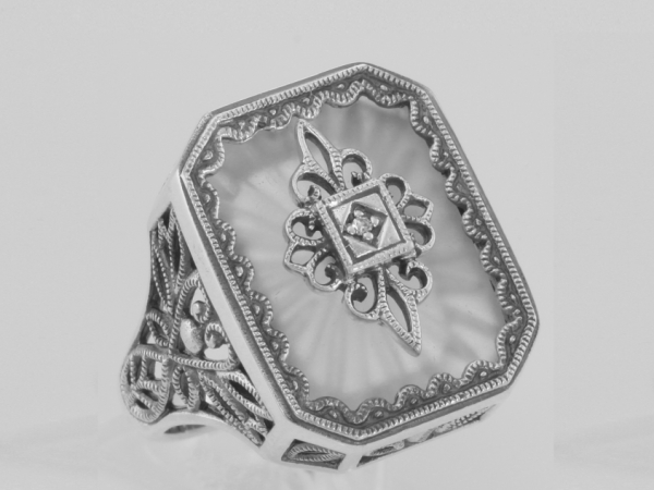 Camphor Glass Art Deco RIng  - This Victorian Style Camphor Glass Sunray Crystal and Diamond Filigree Ring is handcrafted and finished in intricate Sterling Silver detail. The sparkling Diamond filigree center adds beauty and style to the starburst Camphor Glass Crystal. Filigree rings are timeless in style and can be enjoyed, cherished and handed down as precious family heirlooms. This vintage style crystal and diamond filigree ring is new and a quality sterling silver antique and collectible reproduction.