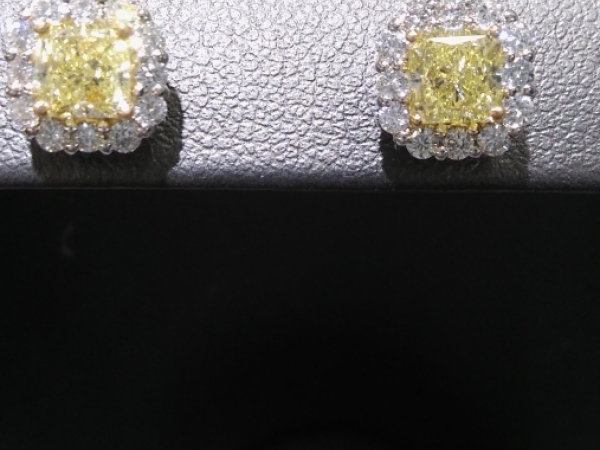 Yellow, Darling! - GORGEOUS VS Fancy yellow diamond earrings - Center princess 1.05 cttw surrounded by .44cttw Ideal cut white diamonds.  Set in 18k tutone.  Approximately 1.50cttw.