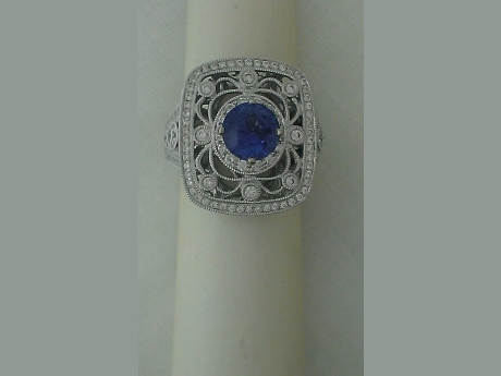 Bangkok Sapphire - 1.55 cttw round Bangkok Sapphire in a beautiful 14k white gold diamond semi mount.  Intricate patterns swirl in an antique look.  .96cttw diamonds.