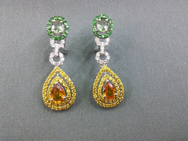 Sweet Sapphire - 14 yellow gold  multi-color sapphires dangle earrings - pear shaped citrine dangle with two surrounding yellow sapphire halos.  A round green sapphire at the ear post is haloed by round green sapphires. A round diamond circle joins them together.  Totals:  .03ct diamonds and 4.31ct of color sapphires.