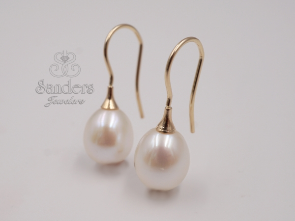 Pearl Earrings - 14K Yellow Gold Pearl Earrings. Elegant elongated Fresh Water Pearls drop from a French wire hook. A classic design.
