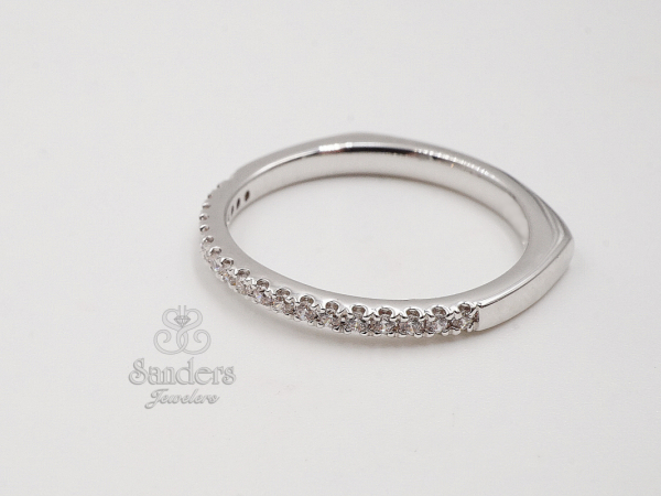 Subtly Curved Diamond Wedding Band - 14K White Gold Diamond Wedding Band. The subtle profile gently curves to elegantly embrace your engagement ring. Diamonds dazzle the top to complete the perfect match. (0.12 tdw) This style can be special ordered in 14K or 18K White, Yellow, and Rose Gold, and Platinum.