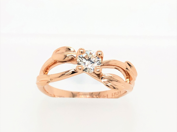 14 KARAT ROSE GOLD LEAF SOLITAIRE - A LITTLE MUSKOKA ...THIS 14 KARAT ROSE GOLD SOLITAIRE HAS ACCENTED GOLD LEAVES ON THE SIDE. PERFECT FOR AN ENGAGEMENT RING OR A RIGHT HAND RING. CENTER DIAMOND WEIGHTS 0.35 CARAT.