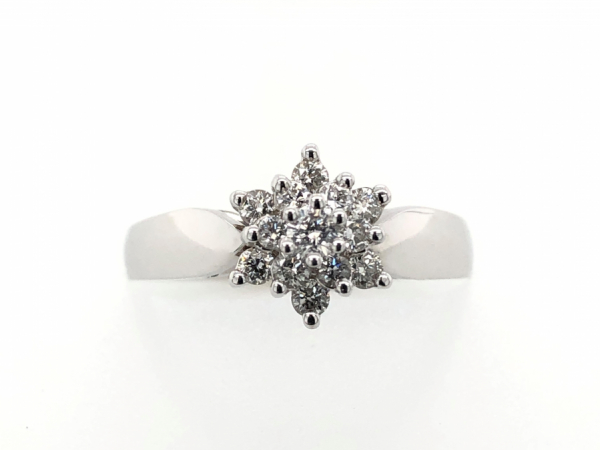 14 KARAT CLUSTER RING - A SPARKLING GROUP OF DIAMONDS, THIS RING IS 14 KARAT WHITE GOLD AND CONTAINS A TOTAL DIAMOND WEIGHT OF 0.36 CARAT.