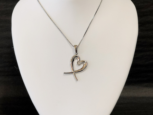 Sterling Silver Heart with Diamond - Sterling Silver Crossed Heart set with a 0.05 diamond.